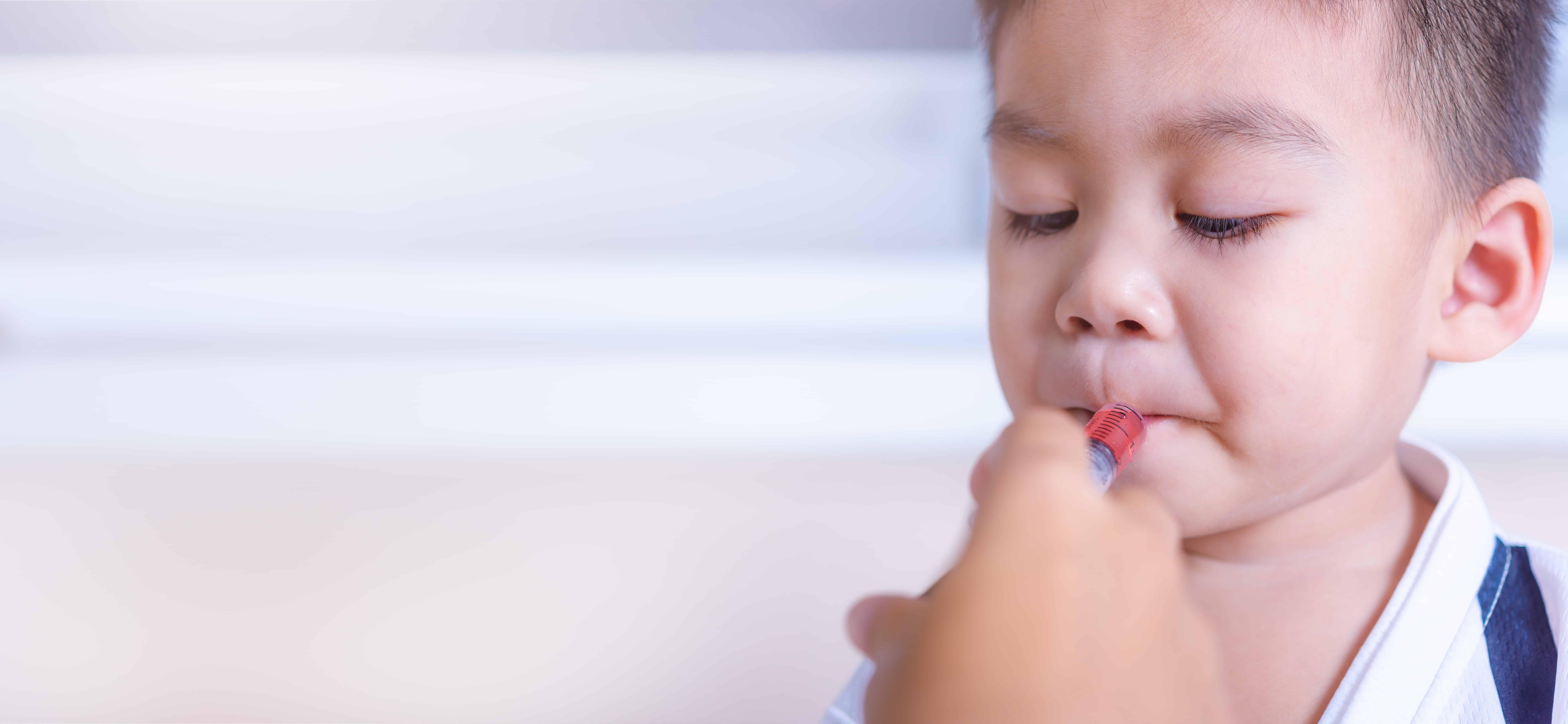 Child receiving medicine via syringe